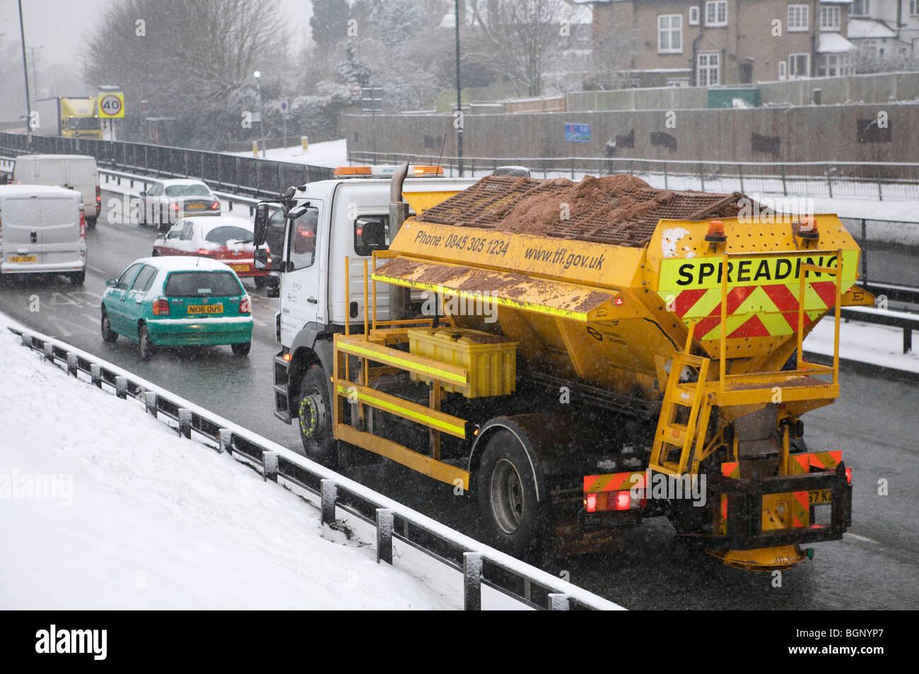 Fresh snow causing traffic chaos at rush hour , london,uk - Stock Image