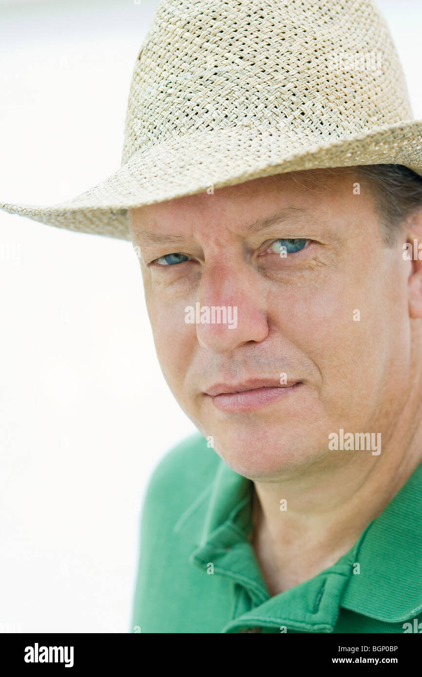 Portrait of a mature man wearing a hat - Stock Image