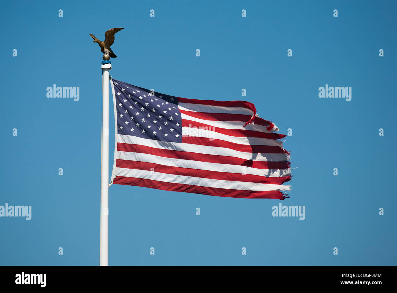 Waving flag of the usa with golden eagle - Stock Image