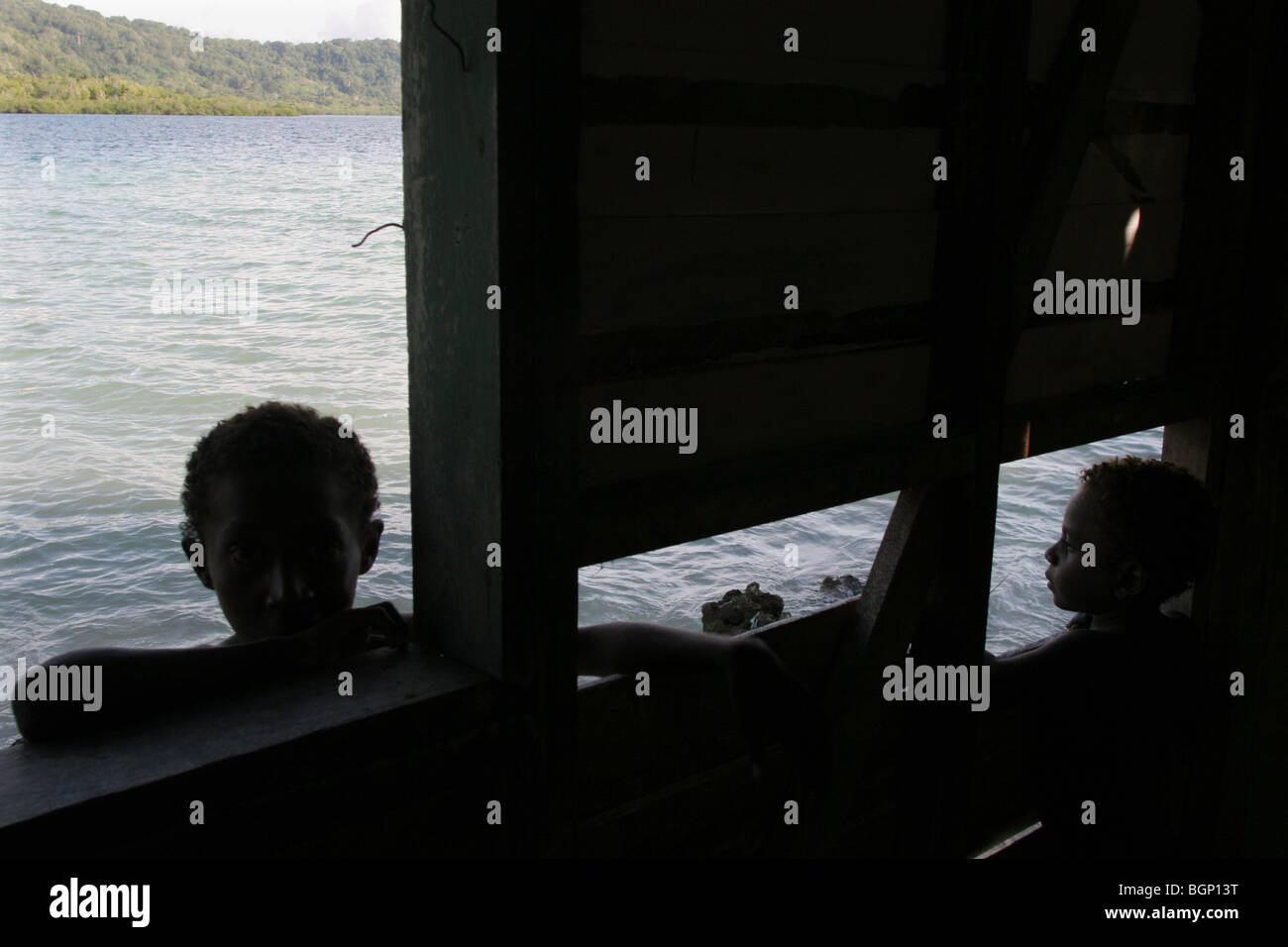 wall of a school, against which the ocean waves now reach, on Karavat Island, Bougainville province, Papua New Guinea - Stock Image