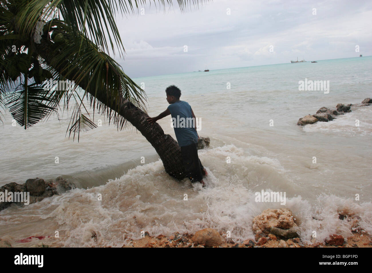 King tides flood property on Kiribati atoll - Stock Image
