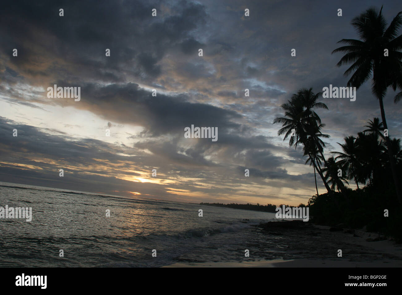 Dusk on the beach on the island of Kiribati in the Pacific Ocean - Stock Image