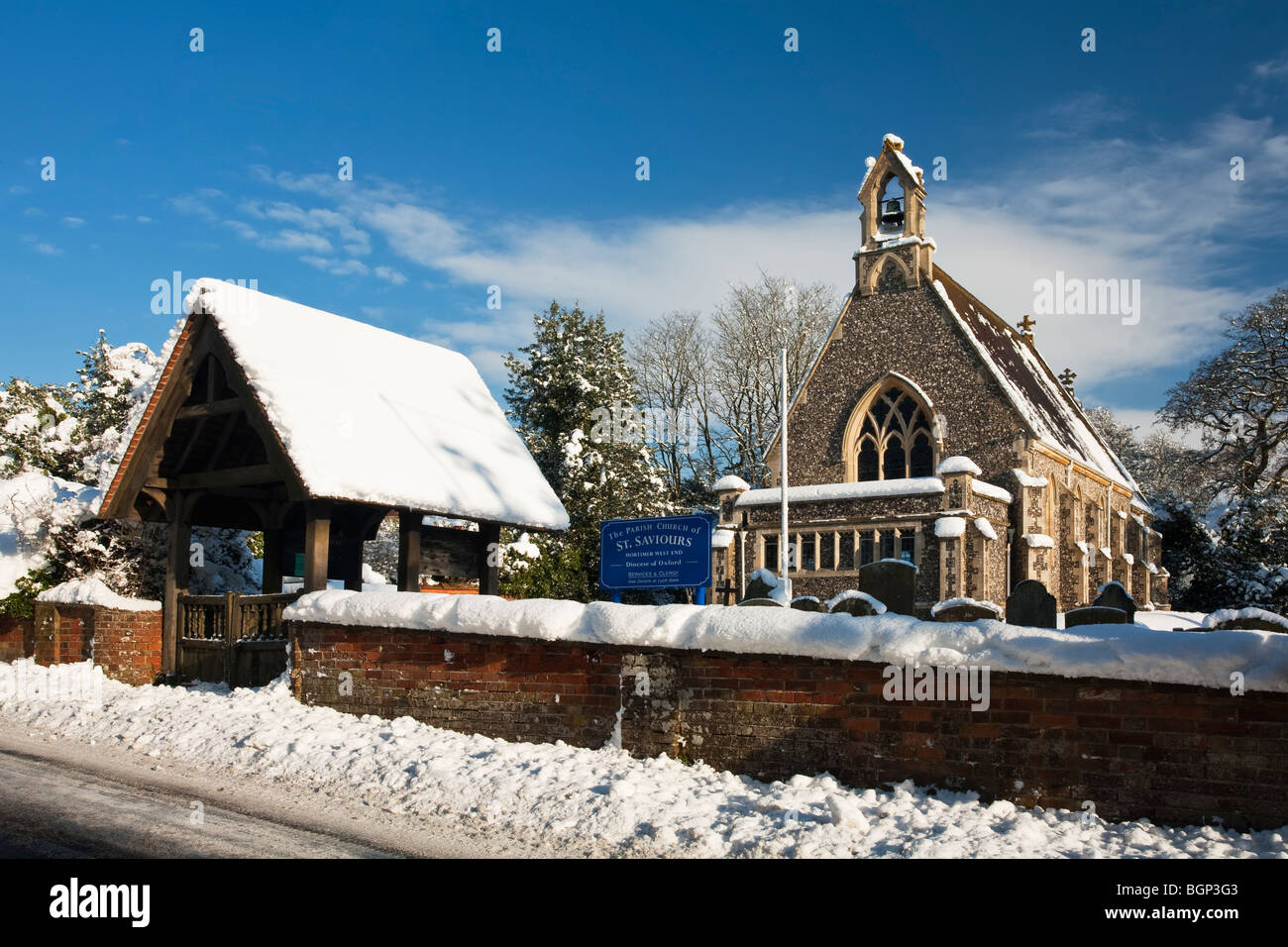 St Saviours Church in the snow, Mortimer West End, Reading, Berkshire, Uk - Stock Image