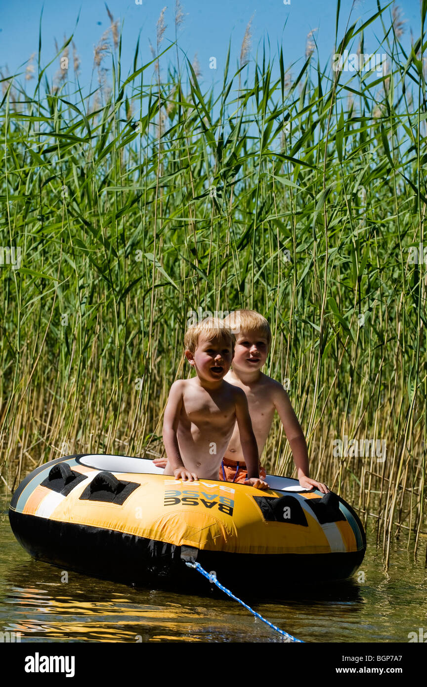 Two boys in a bathing ring, Sweden Stock Photo: 27533583 - Alamy