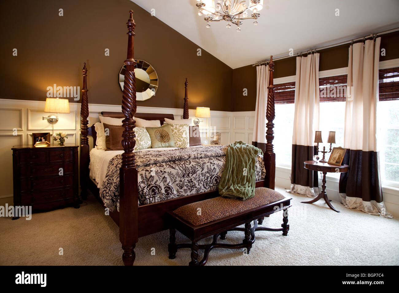 Master Bedroom With King Size Four Poster Bed Covered With Matching Fabric  Duvet And Stack Of Pillows. Cabinets On The Side