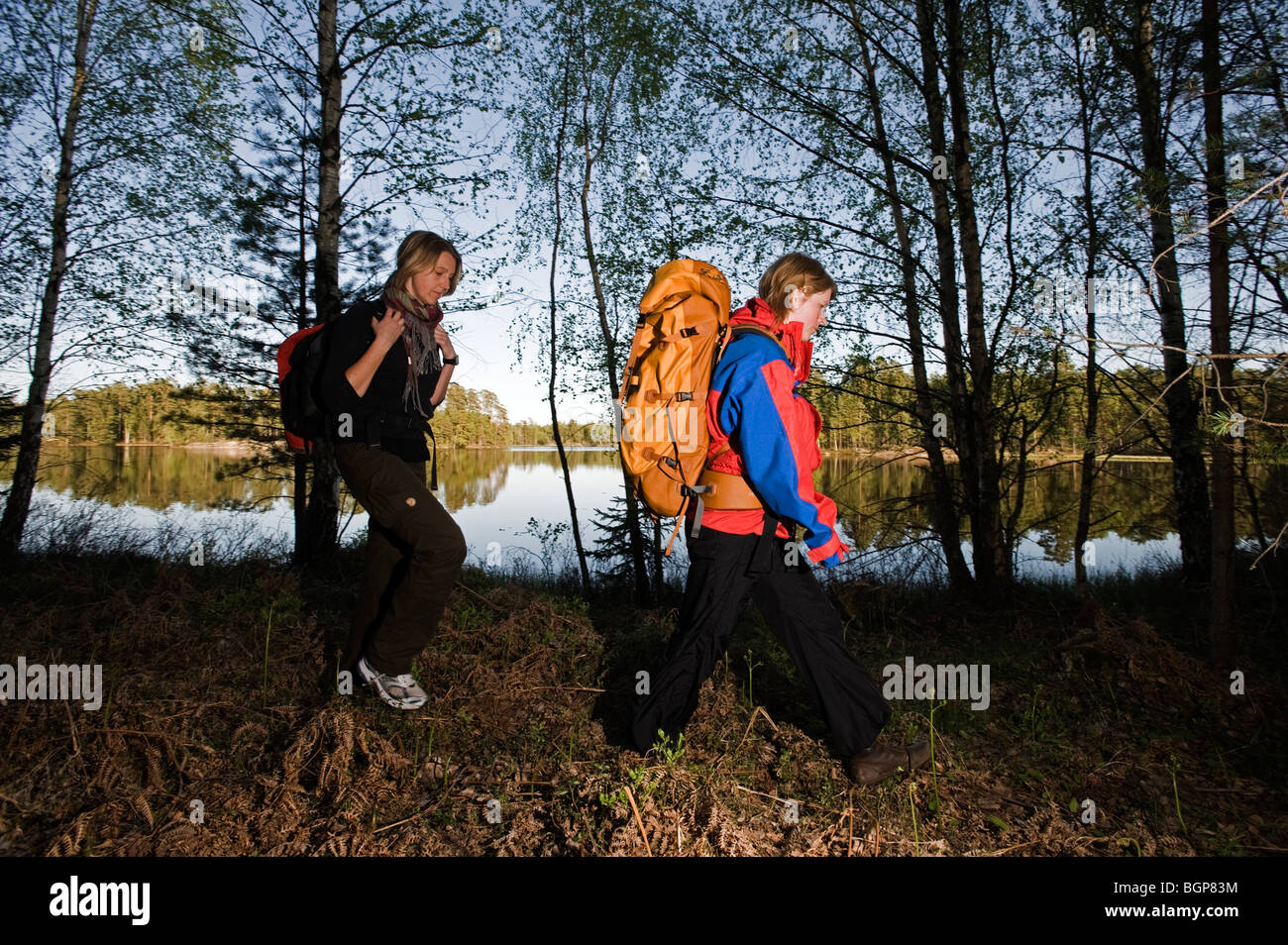 Two women during a walking-tour, Sweden. - Stock Image