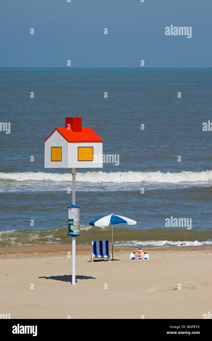 Reference point in the shape of house for lost children at seaside resort at beach along the North Sea coast, Koksijde, - Stock Image