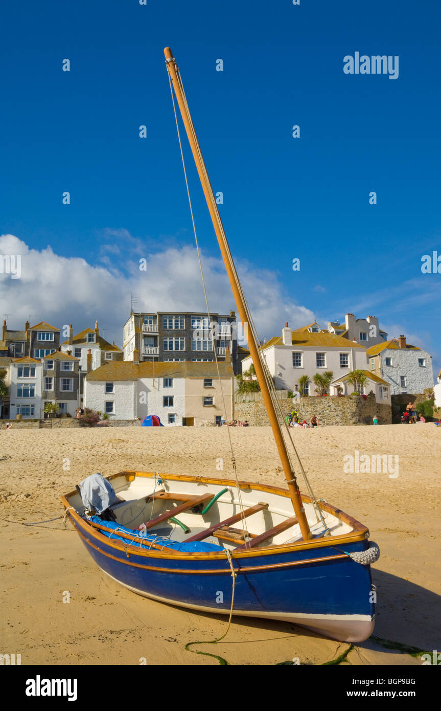 Small fishing boat beached at low tide on The Island or St. Ives head St Ives North Cornwall England GB UK EU Europe Stock Photo