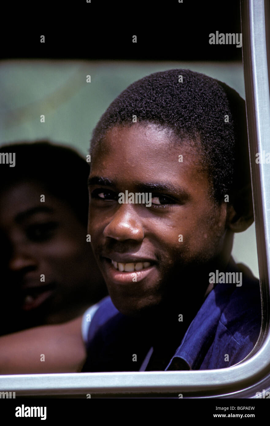 Martinican boy, Martinican, boy, male student, student on school bus, student, child, school bus, Le Marin, Martinique, - Stock Image