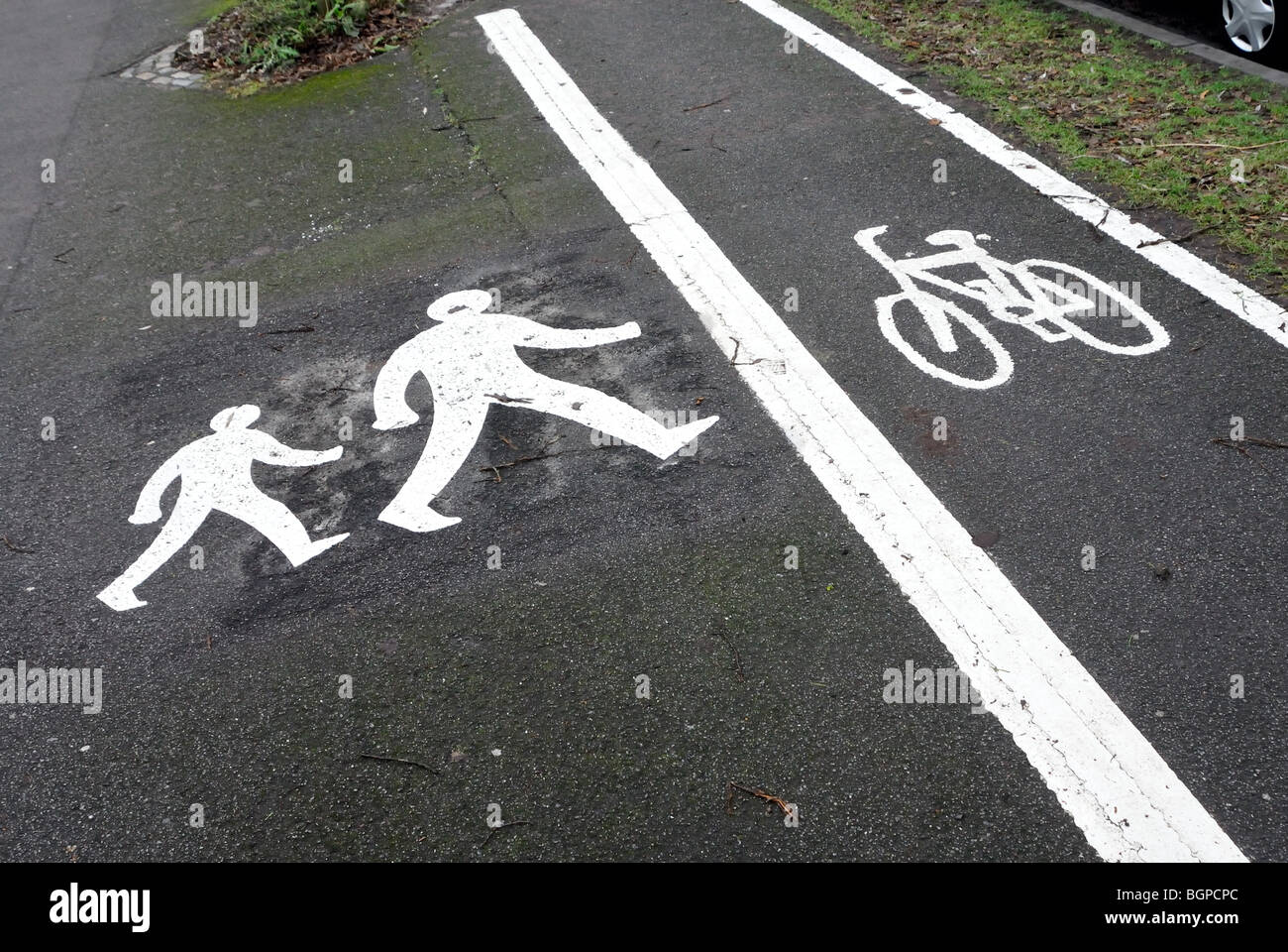 Pedestrian road marking cycle lane - Stock Image