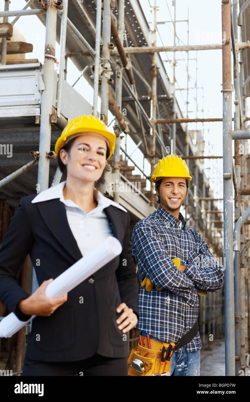 female engineer and construction worker - Stock Image
