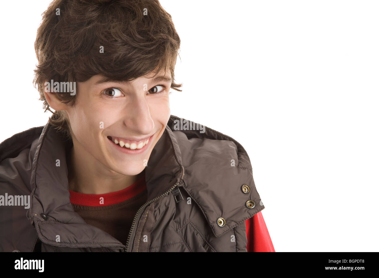 Portrait of young man laughing isolated on white background - Stock Image