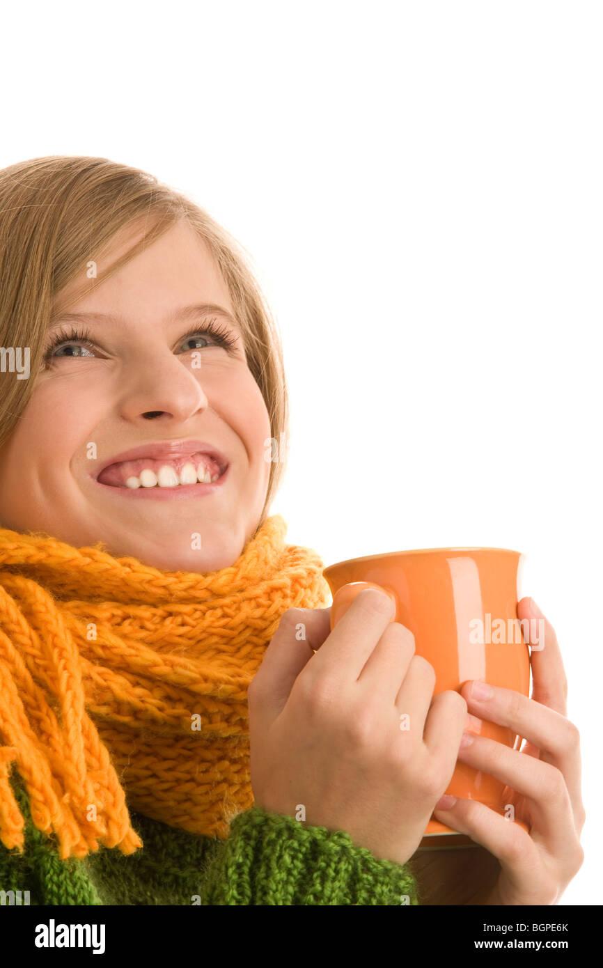 Teenage girl holding mug with hot beverage isolated on white background Stock Photo