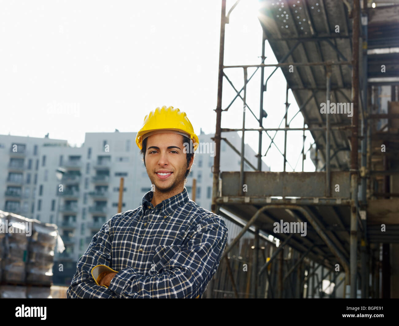 construction worker looking at camera - Stock Image