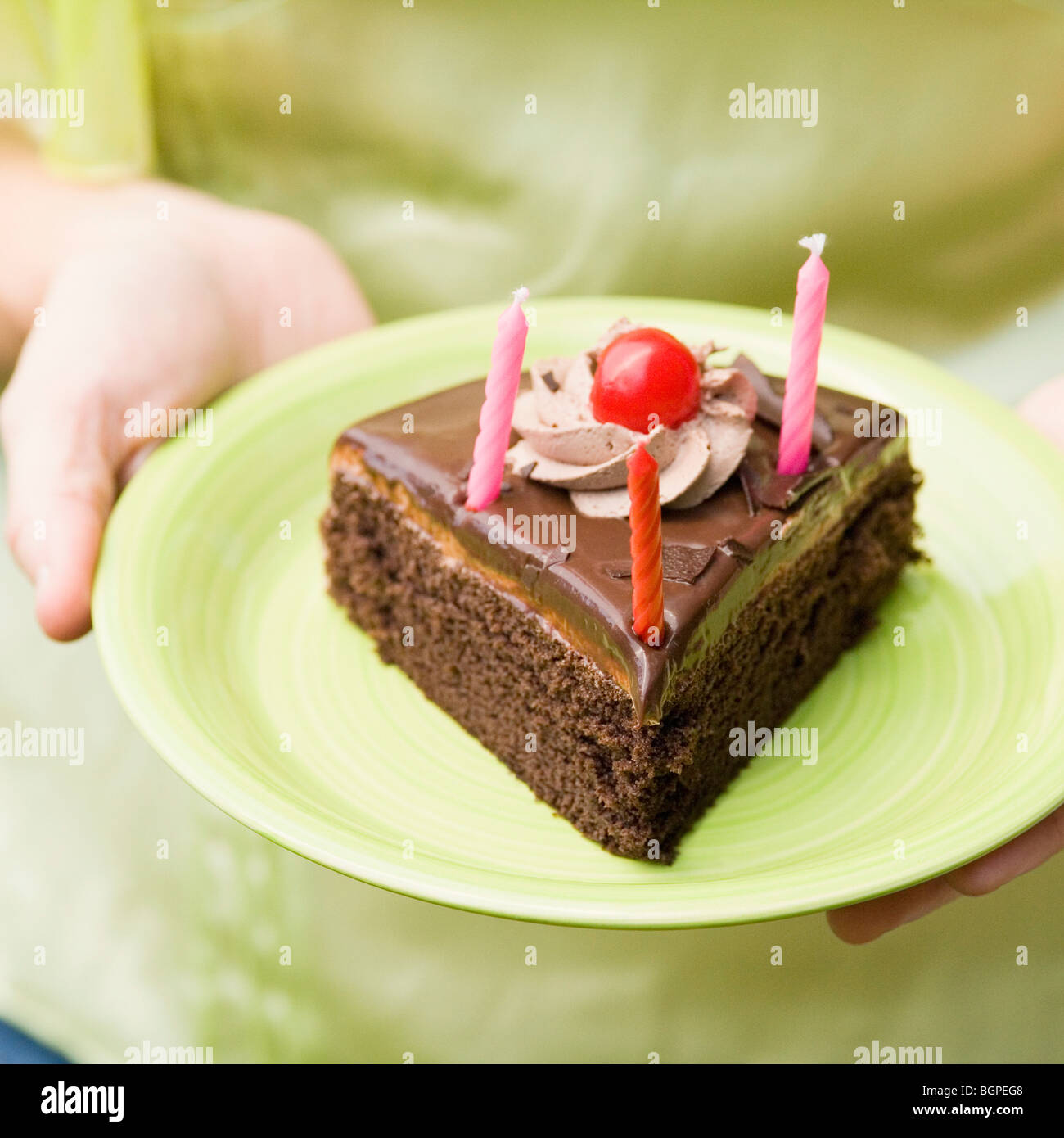 Mid section view of a woman holding a plate of birthday cake slice - Stock Image & Slice Chocolate Cake On Plate Stock Photos u0026 Slice Chocolate Cake On ...