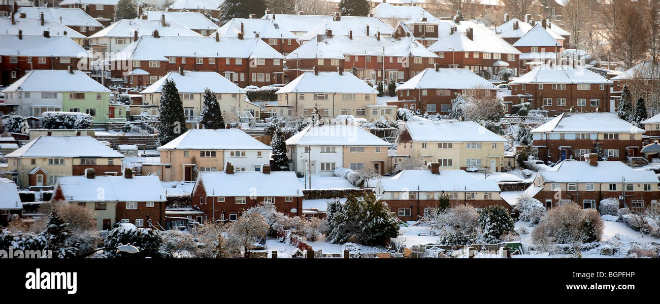 Snow covered rooftops on houses on the outskirts of Brighton Sussex UK Stock Photo