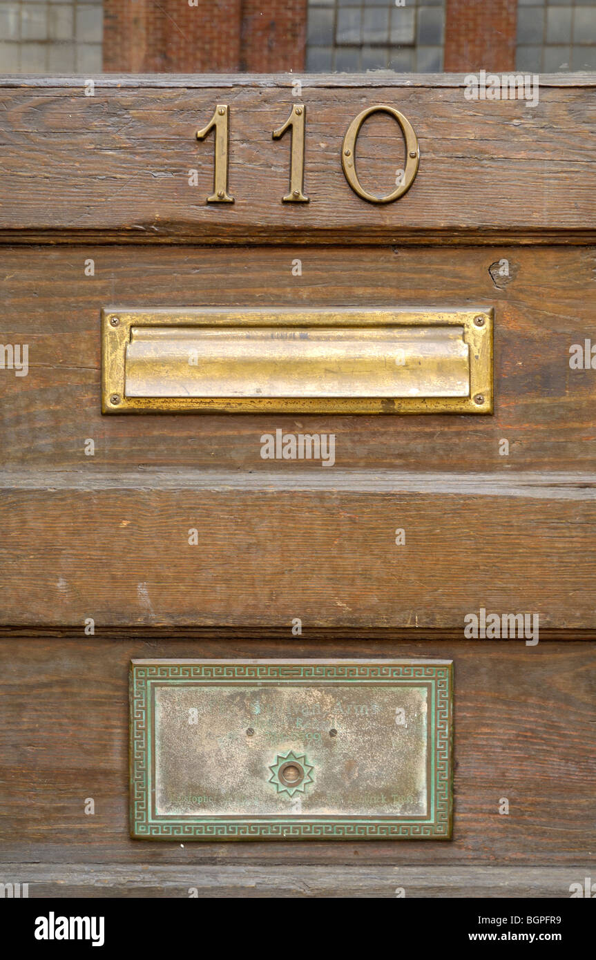 An old door with number 110 and brass mail slots in the Old City section of - Mail Slot In Antique Wooden Door Stock Photos & Mail Slot In Antique