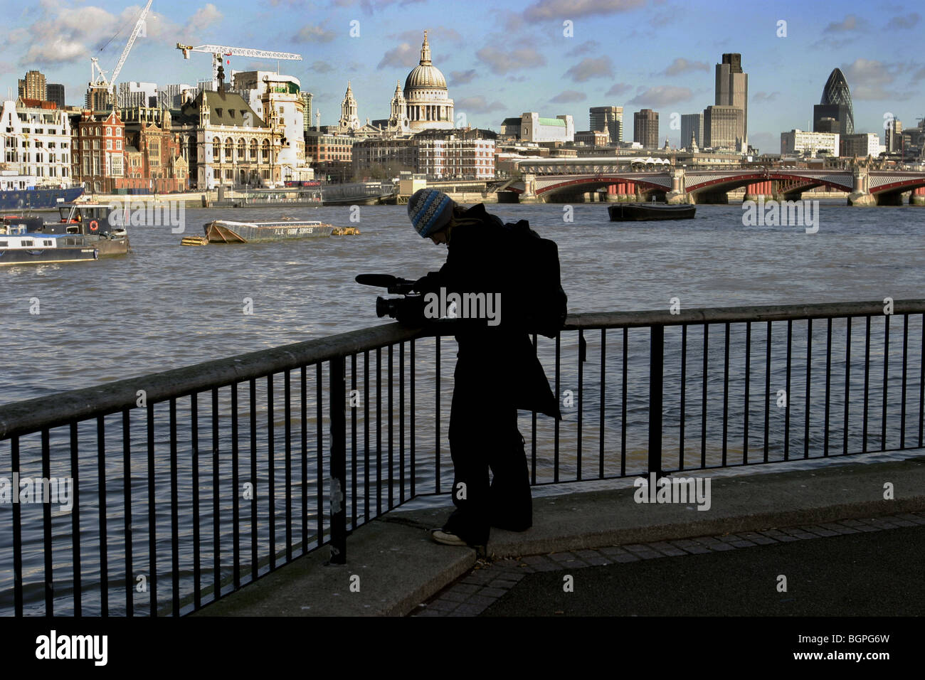 Girl filming on the South bank of the river Thames London UK Stock Photo