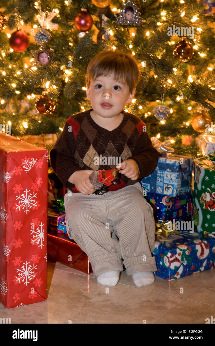 Christmas Gifts For 18 Month Old Boy.18 Month Old Boy With Christmas Presents And Tree Mr Stock