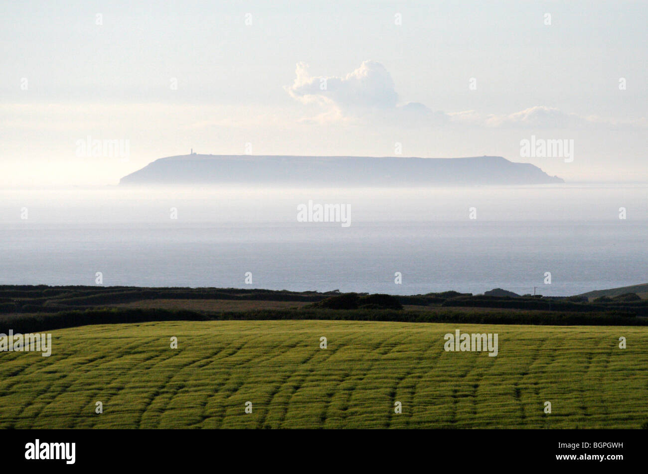 Lundy Island floating in the misty Bristol  Channel Taken from Hartland - Stock Image