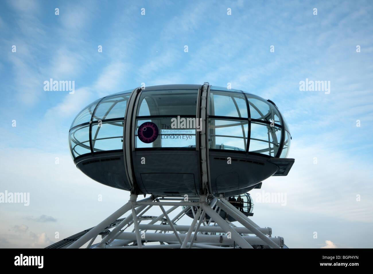 A london eye pod slowly rotates into the december sunset - Stock Image