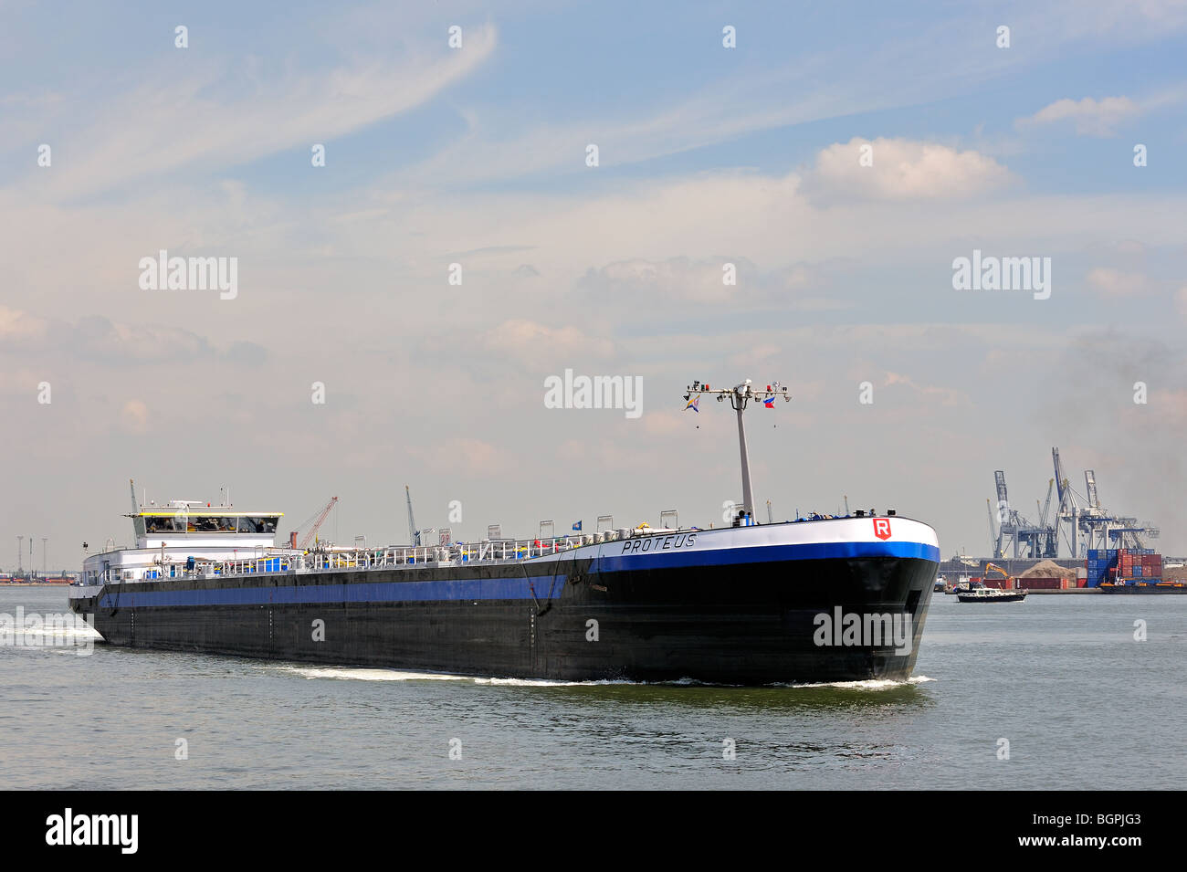 Inland vessel sailing into dock of the Antwerp harbour, Belgium - Stock Image