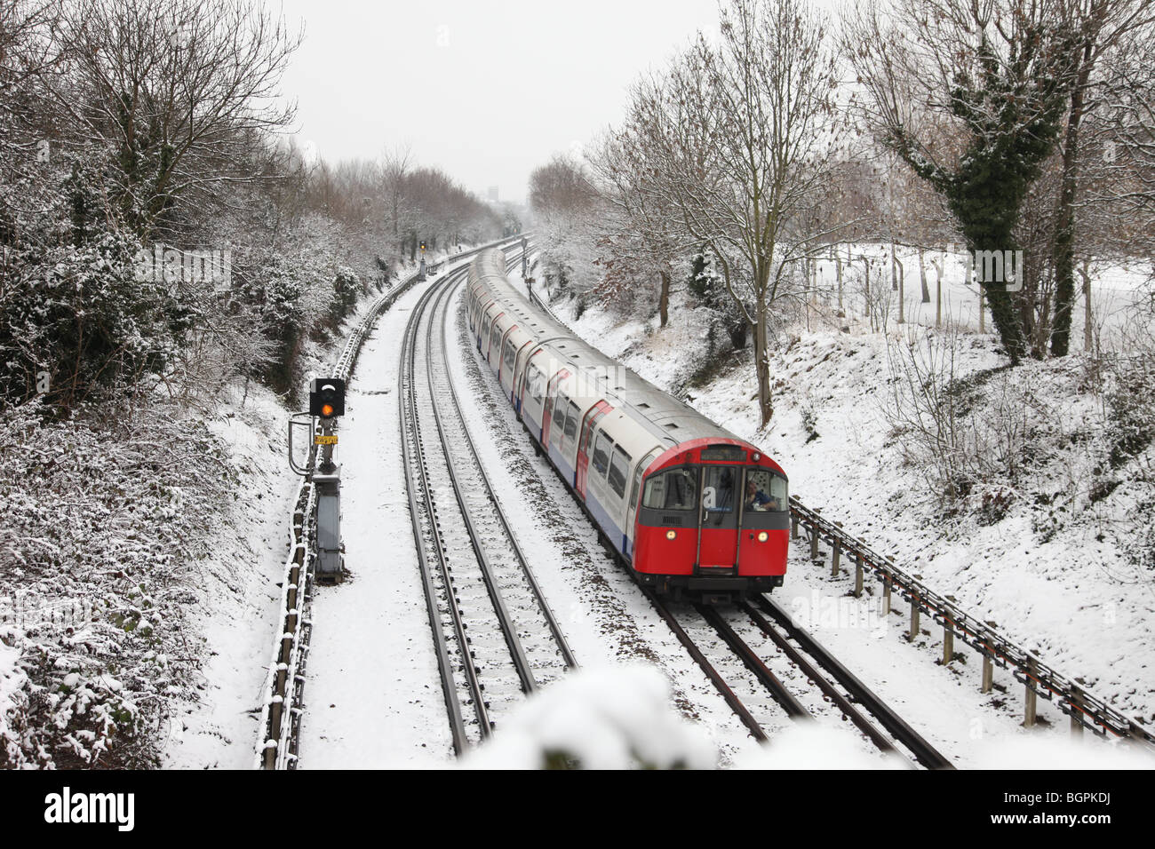 London Underground Tube train in snow covered scene - Stock Image