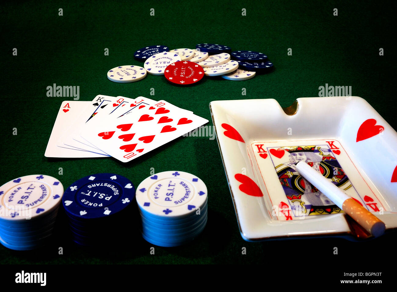 poker table showing cards and poker chips - Stock Image