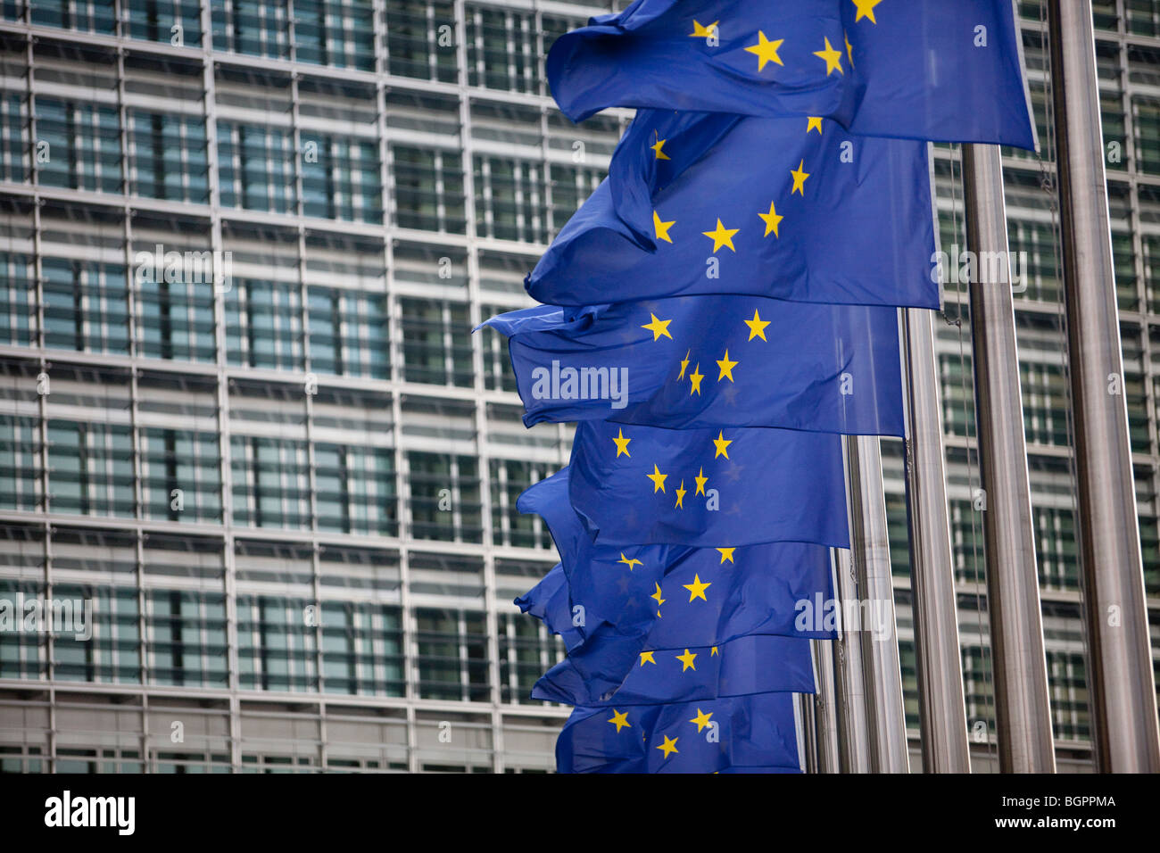 European flags waving next to the European Commission headquarters in Brussels - Stock Image