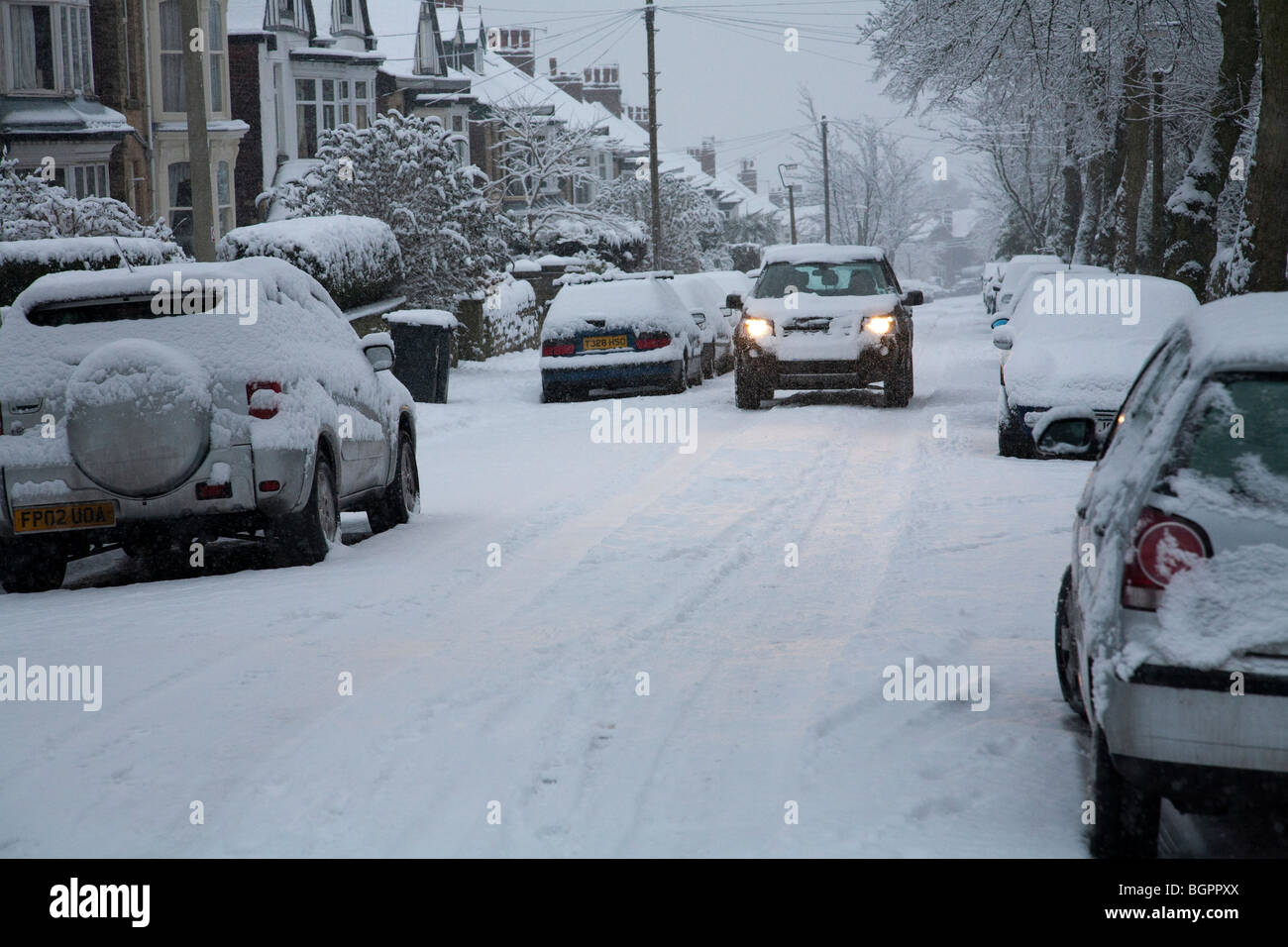 A car in extreme winter weather,Ecclesall Road, Sheffield in