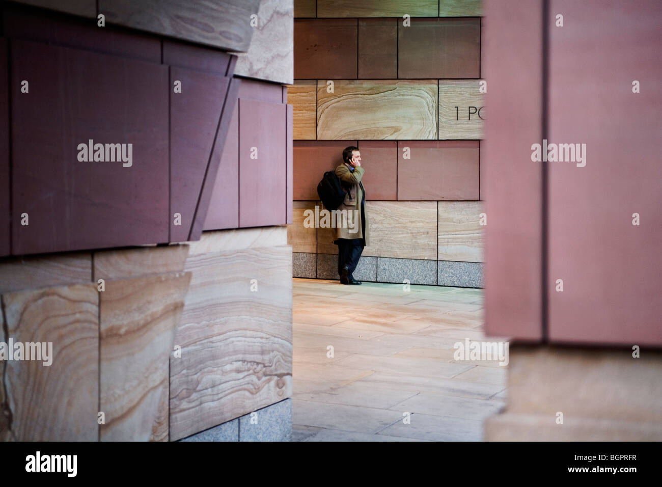 Man on the phone at Number 1 Poultry, London, England, Britain, UK - Stock Image