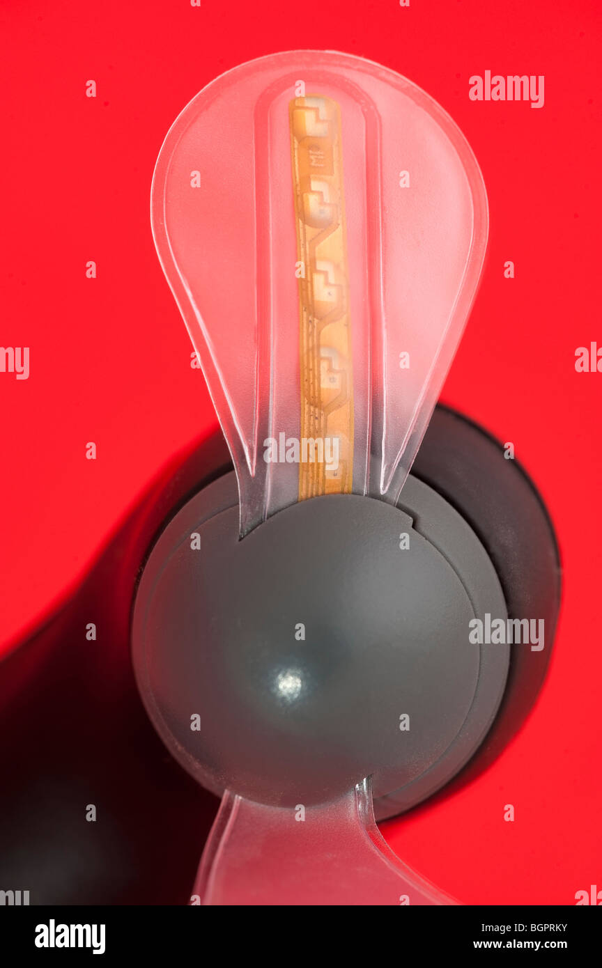 Led lights encased between plastic on a small portable fan blade - Stock Image