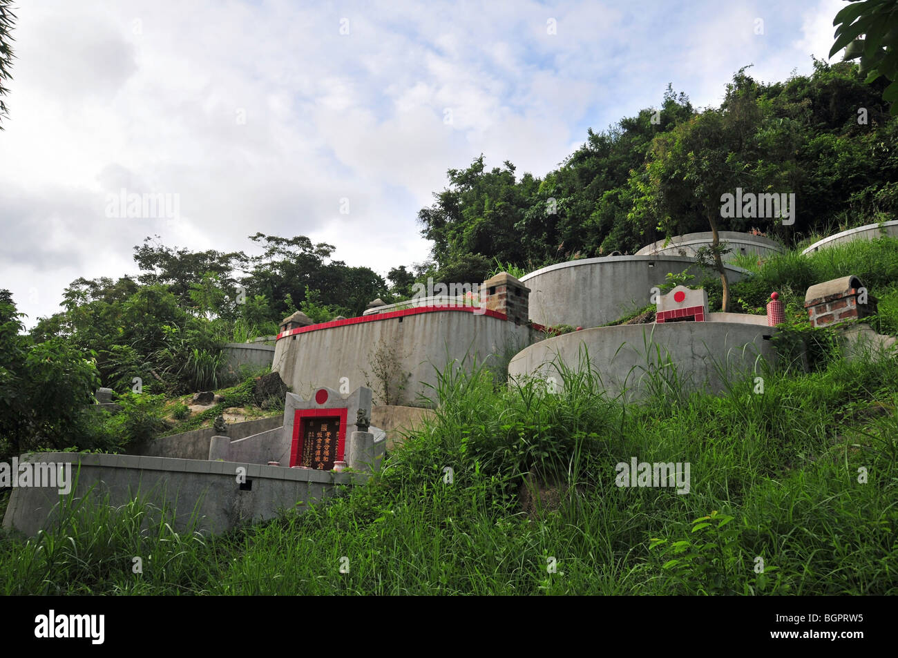 Chinese permanent cemetery on a hillside by the steep path approaching Sok Kwu Wan from Tung O, Lamma Island, Hong - Stock Image