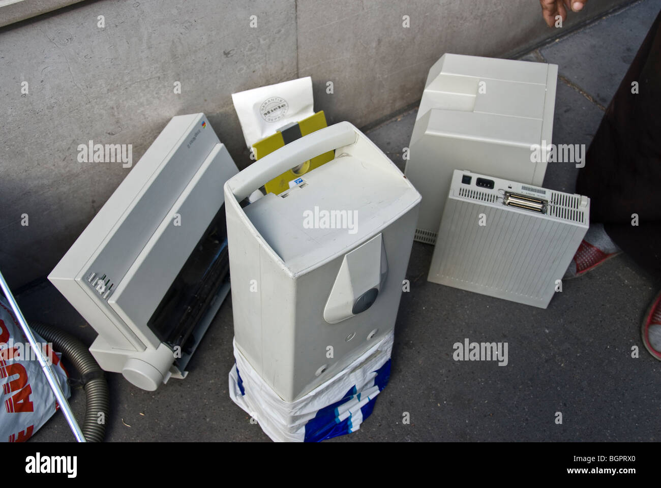 Environment, MAC Computer Being Thrown out for Garbage on Street - Stock Image