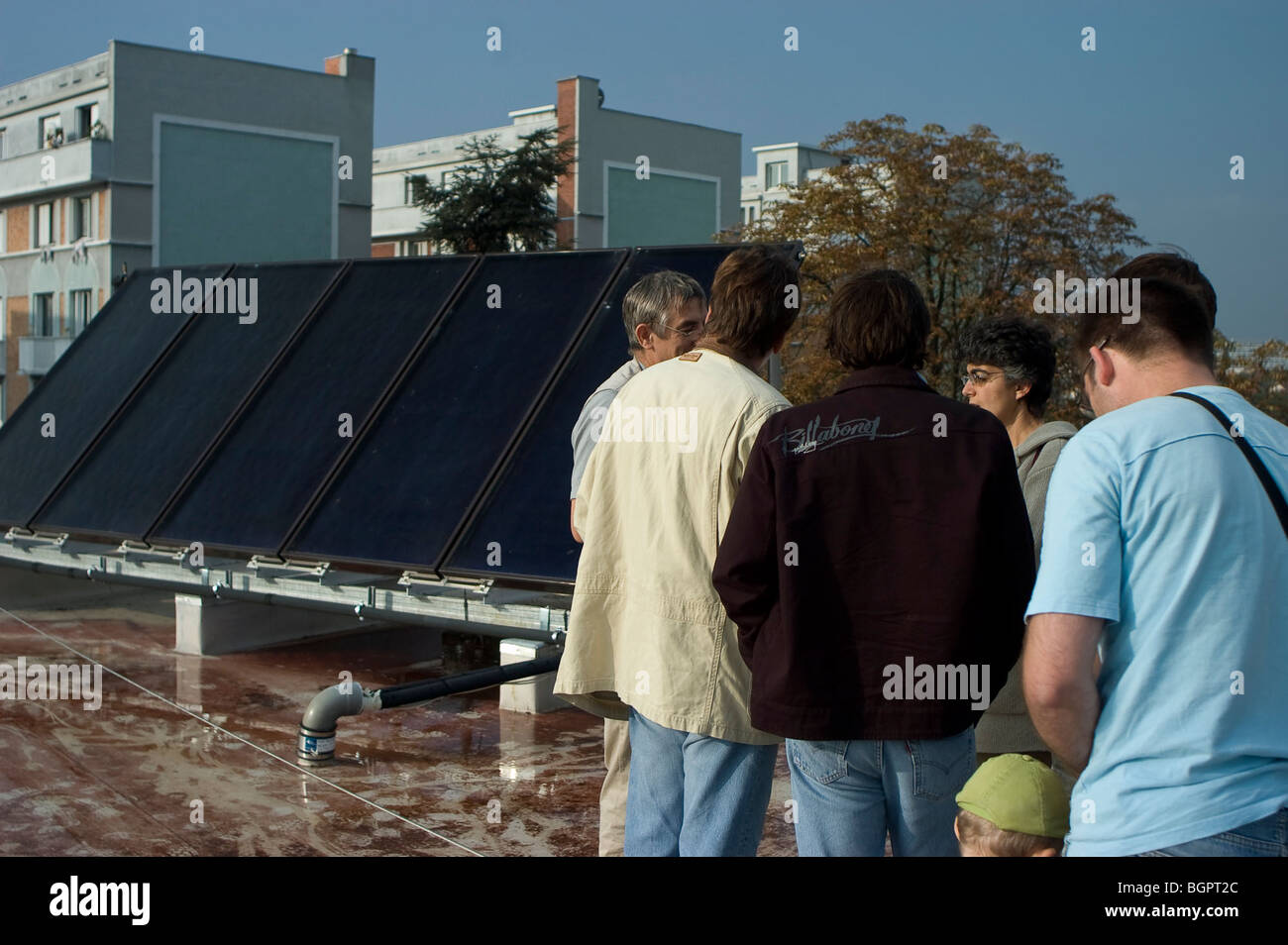 Montreuil, France, Open House Solar House in Paris Suburbs, People Visiting Roof of Building with Solar Panels - Stock Image