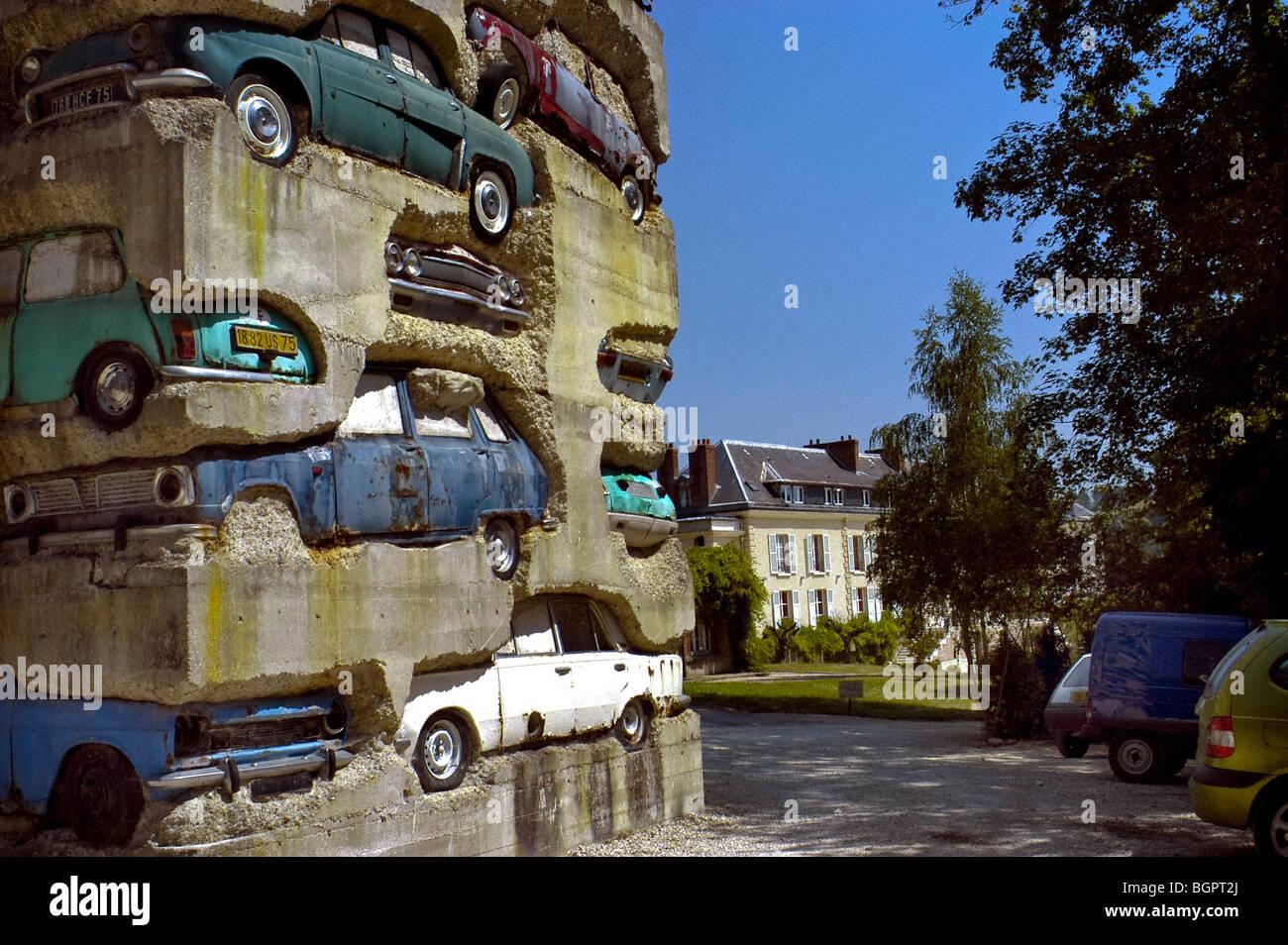 """PARIS, France - Public Sculpture """"Long Term Parking"""" (Artist Cre-dit: Arman,1982, & Domaine du Montcel), Stock Photo"""
