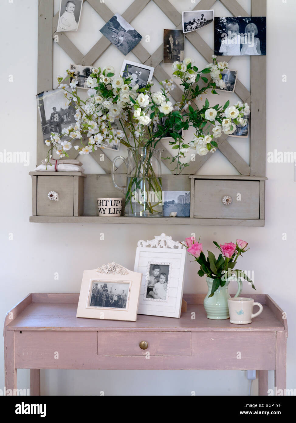 country kitchen side table with photo frames and flowers stock photo