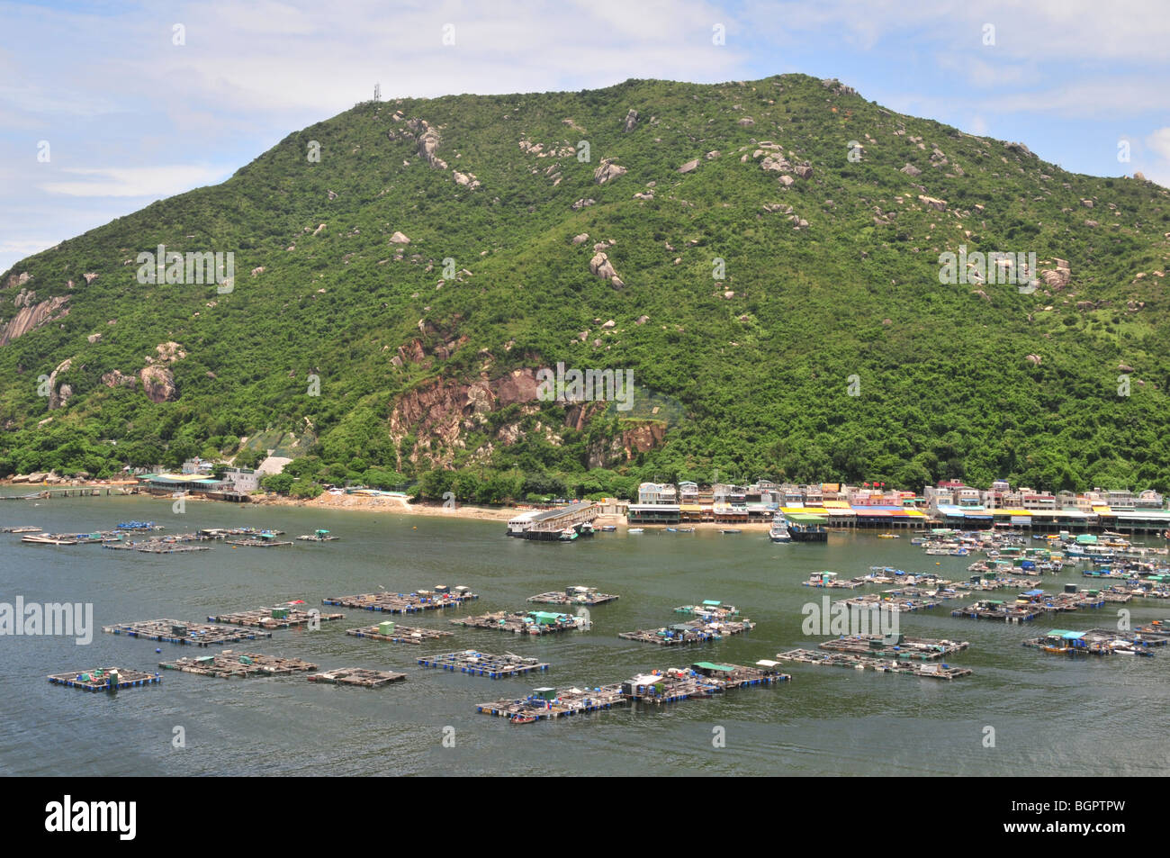 View of Sok Kwu Wan and fish farm, looking east from the Route 1 Family Trail from Yung Shue Wan, Lamma Island, - Stock Image