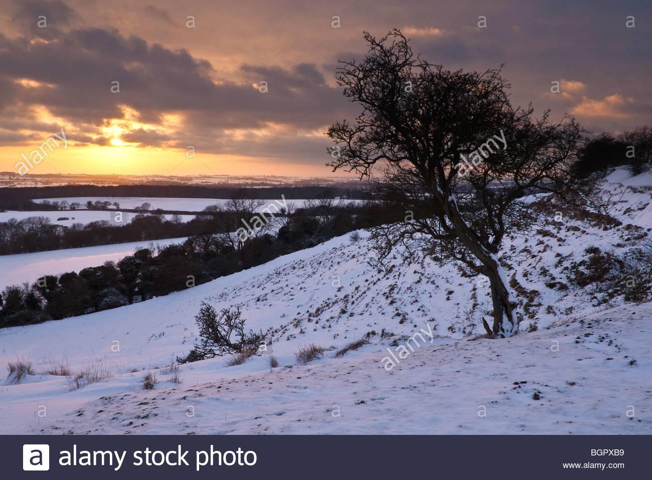 Sunset and snow, Postling Down, Kent, UK. - Stock Image