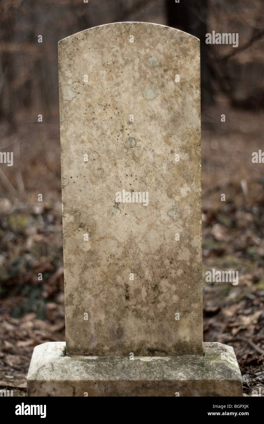 Blank weathered tombstone. Includes clipping path for the tombstone. - Stock Image