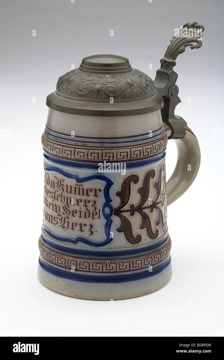 Stoneware 1/2 litre German Beer Stein pewter lid - Stock Image
