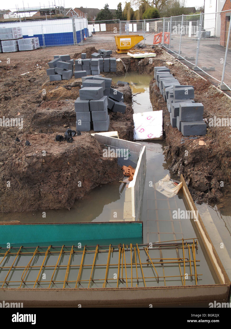 Flooded foundations on a construction site in the U.K. - Stock Image