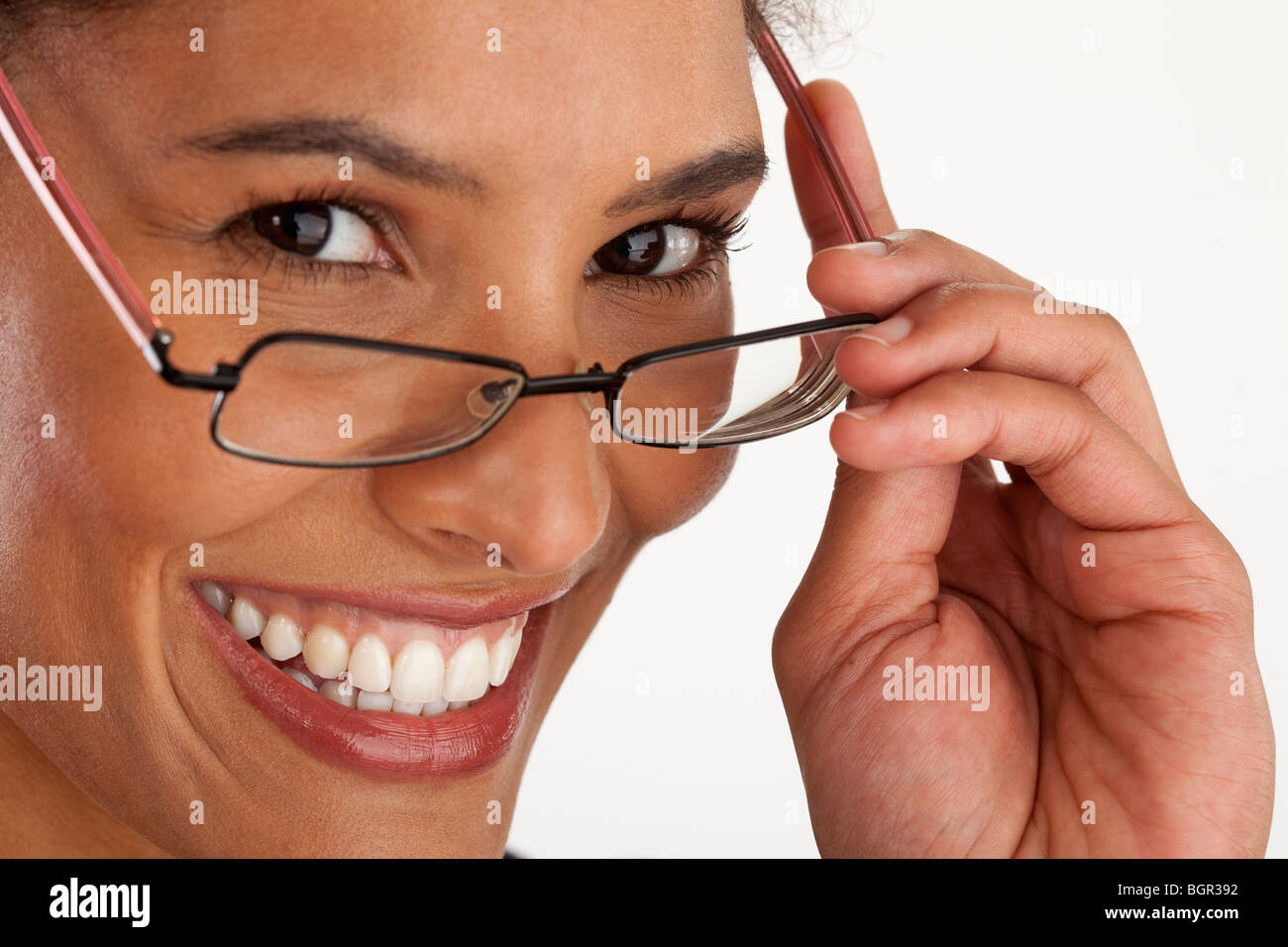 Closeup of young woman wearing glasses. Horizontally framed shot. - Stock Image
