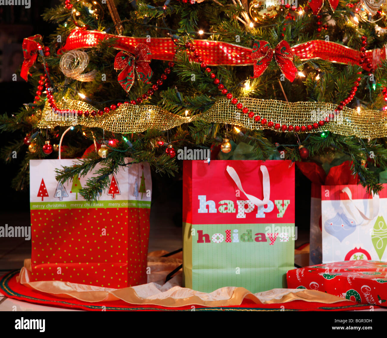 Three gift boxes and a gift box under a home-decorated Christmas ...