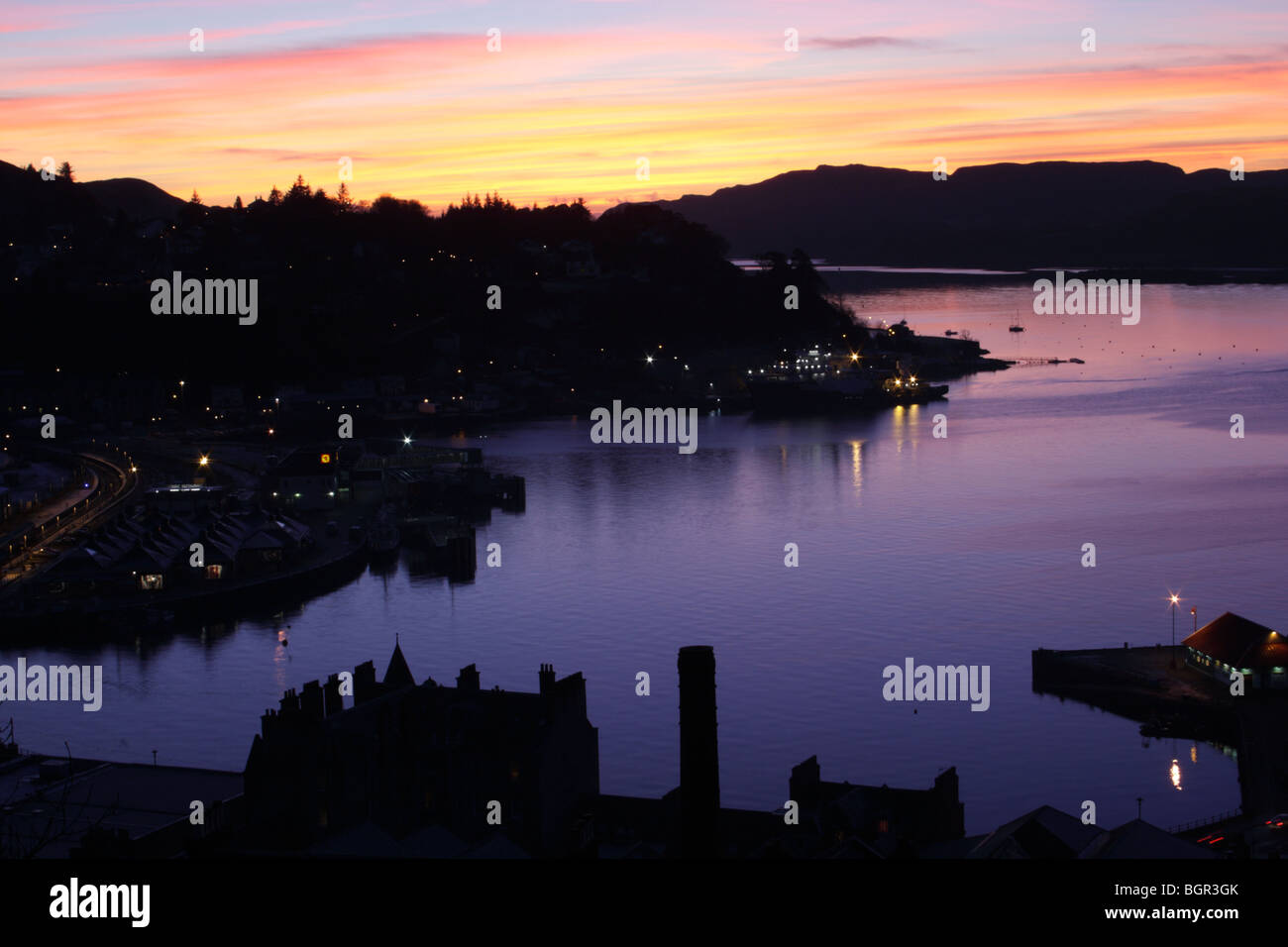 Sunset over Oban Harbor, Oban (Argyll, Scotland) view from McCaig's Towet Stock Photo