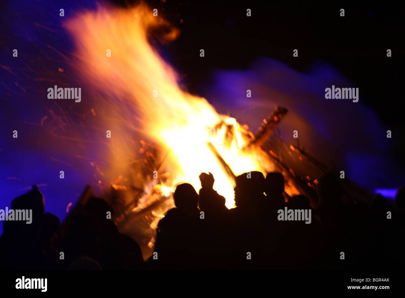 people in front of a big camp fire, Essen, NRW, Germany - Stock Image