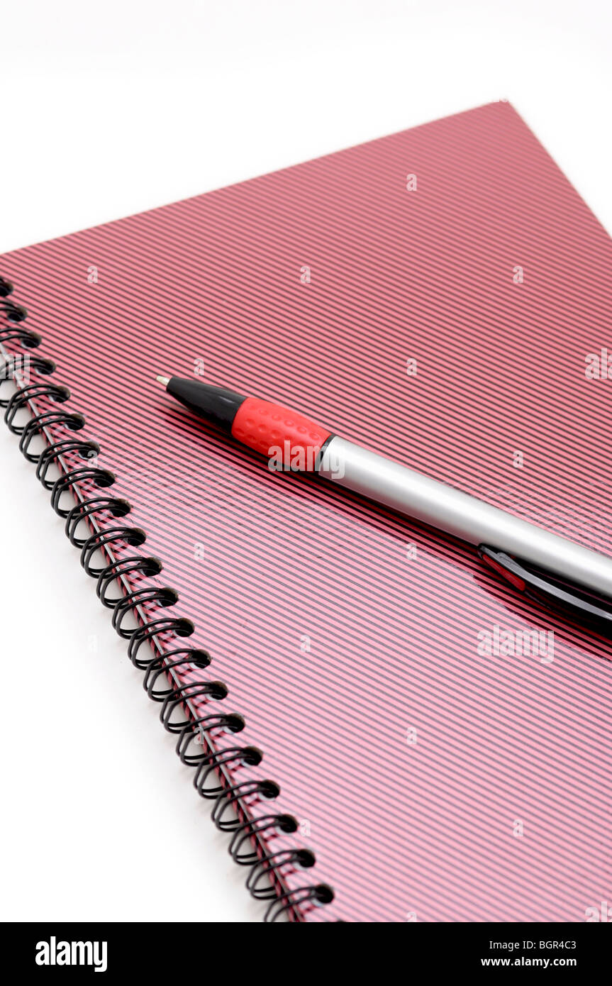 Closed Notebook and Pen - Stock Image