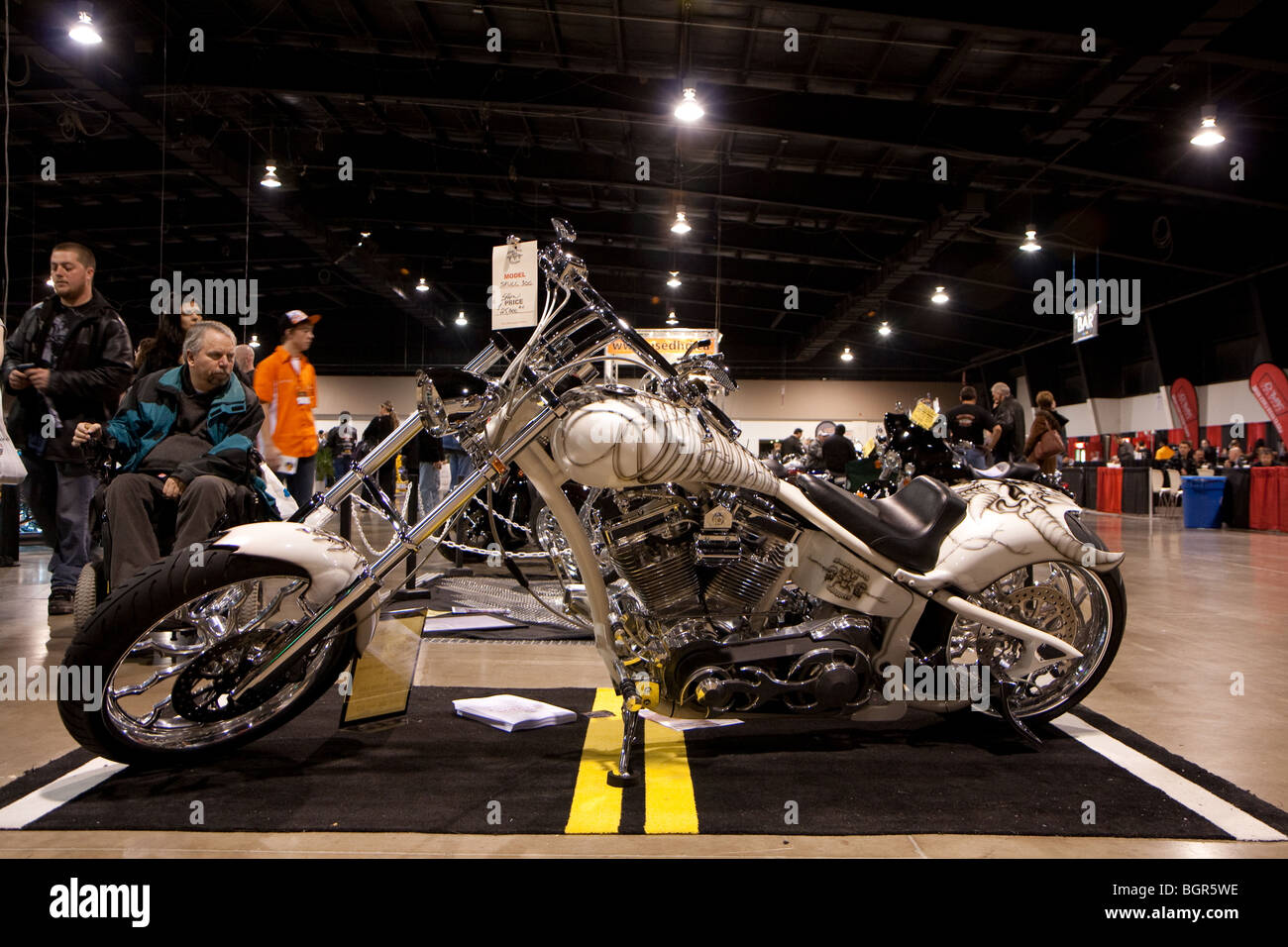 A Customized Motorcycle Or Chopper With Custom Paint Job On Display And For Sale In