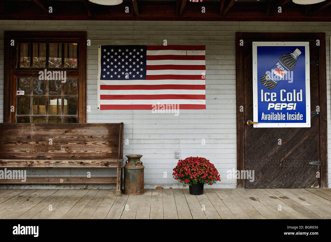 American Flag Displayed on the Porch at the Wolf River Post Office and Welcome Center in Pall Mall, Tennessee - Stock Image
