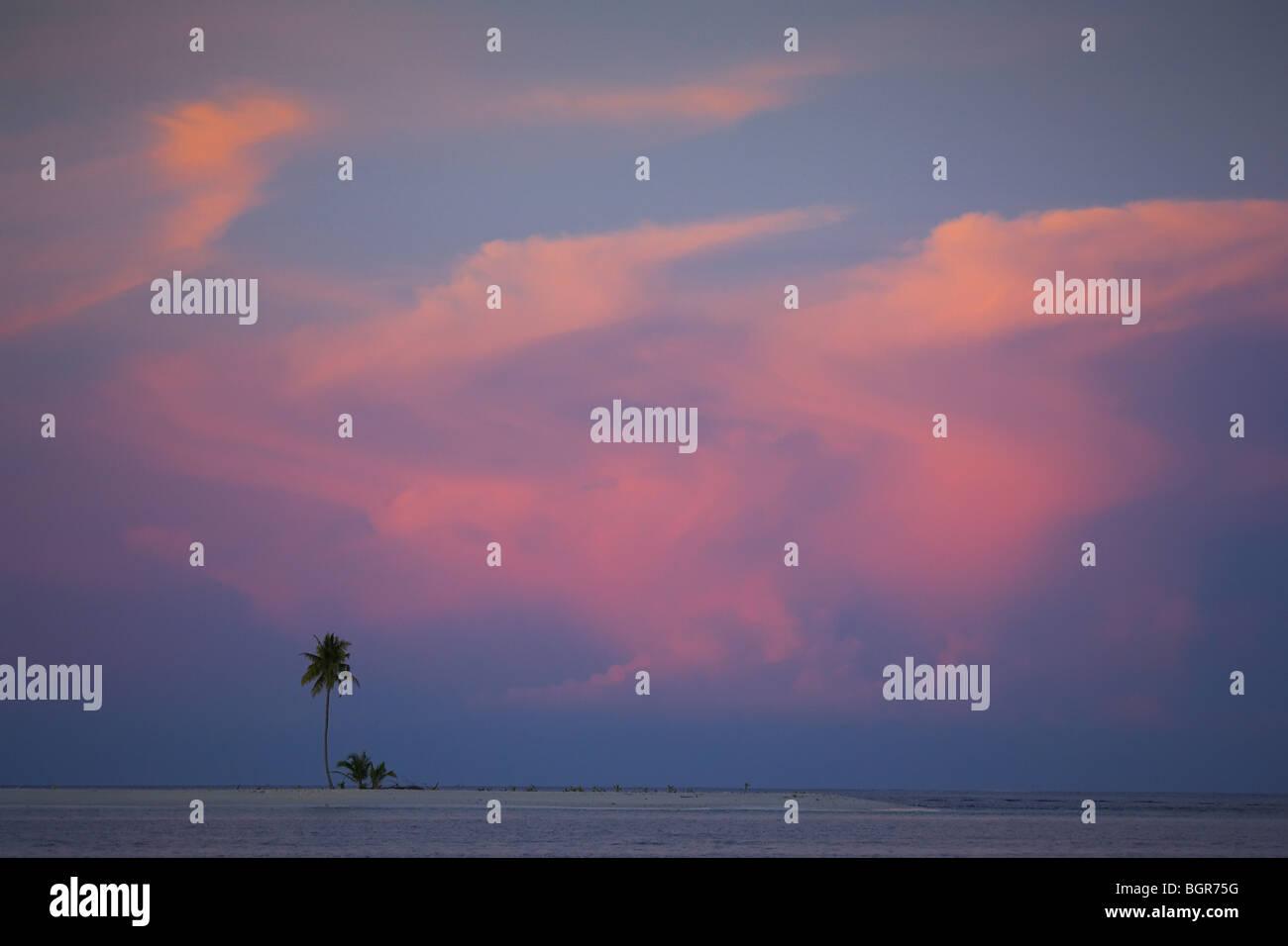 Sunset over sand island - Stock Image